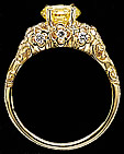 Gold ring and  fancy intense yellow emerald cut